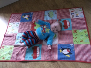 """And you need another picture of me with the whole quilt in, for the blog!"""