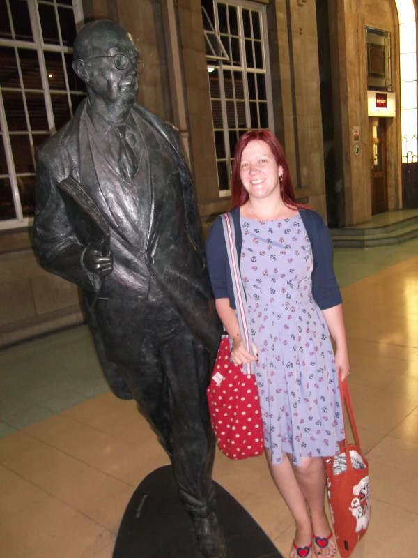 Me with a larger-than-life statue of Philip Larkin, a famous British poet who was born in Hull.