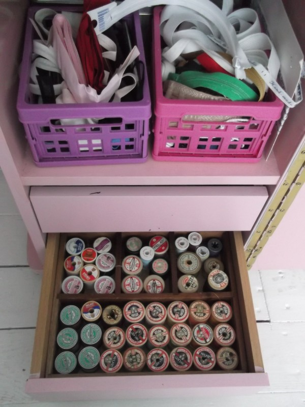 Older spools of thread in the bottom drawer.  Bias binding, elastic, zippers etc in the mini crates.