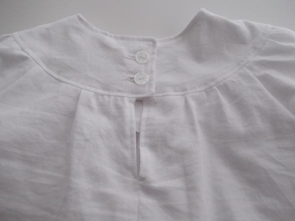 Back yoke button fastening