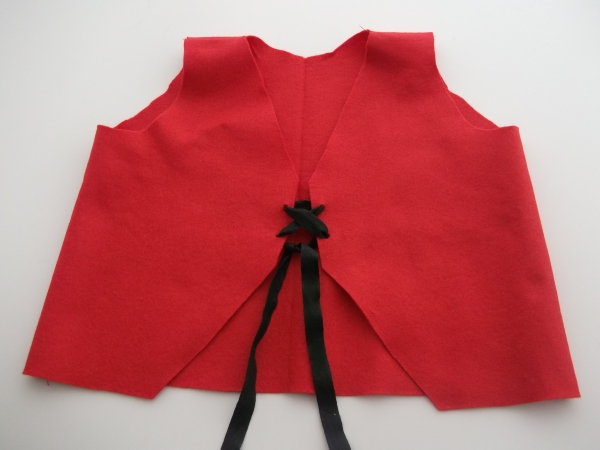 Red felted wool waistcoat with black lacing