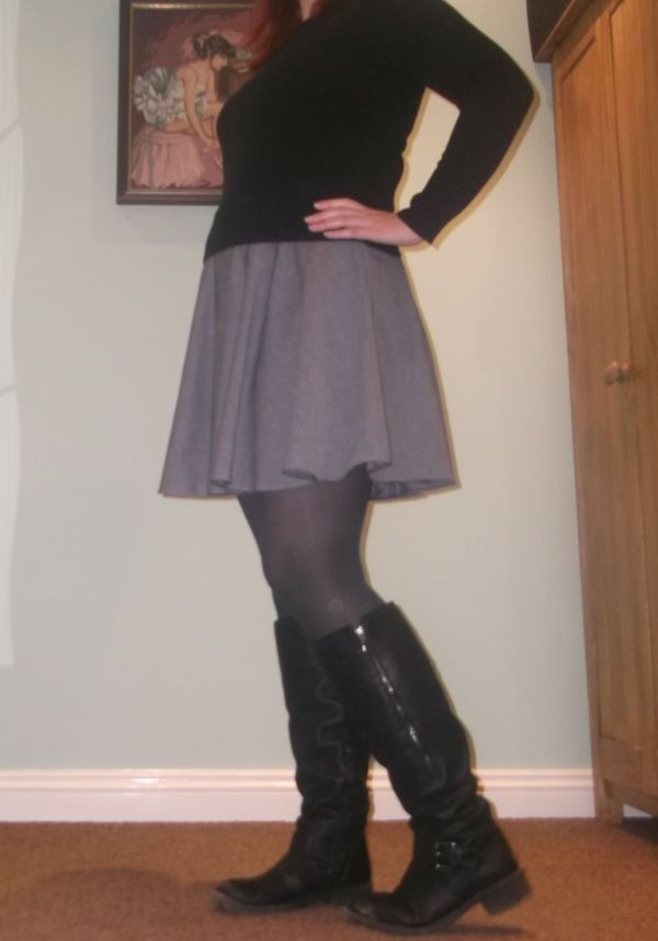 With a jumper, tights and boots