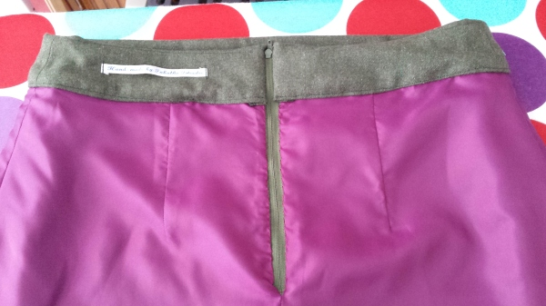 Inside - back zipper, lining and label