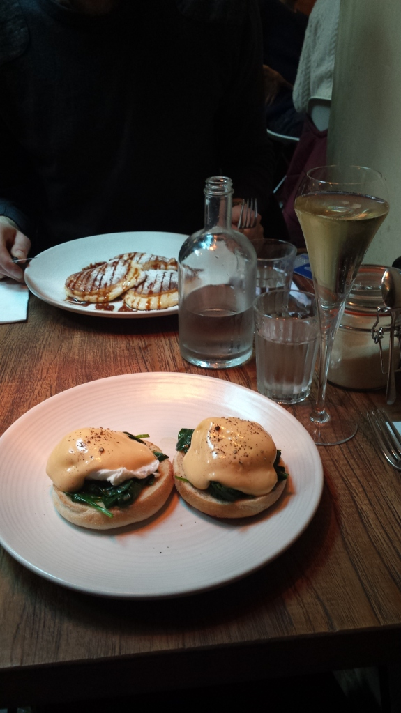 Champagne brunch at Karpo. Eggs Florentine Benedict for me, banana and salted caramel buttermilk pancakes for him.