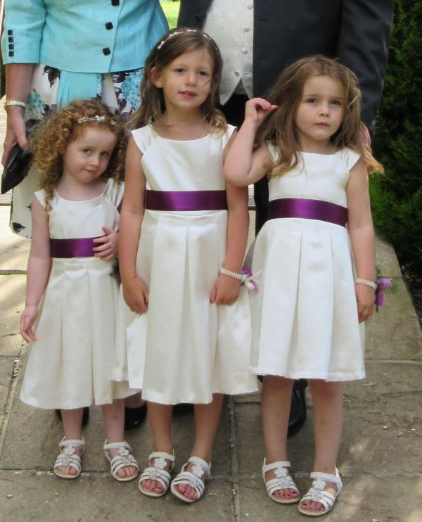 Three flower girls - my daughter on the right