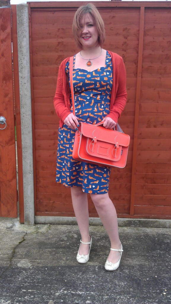 Orange cardigan and satchel
