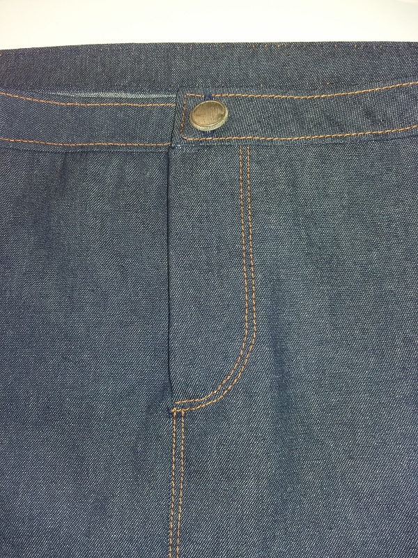 Button fastening at top of fly
